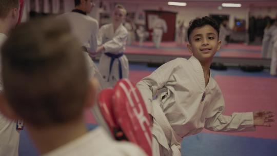 Voor zijn gevoel hoort Mustafa bij de kinderen die ook taekwondo doen.
