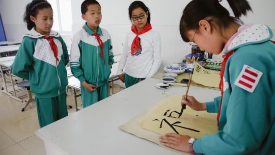 Ke-han gebruikt vier of vijf vellen kalligrafie-papier per dag