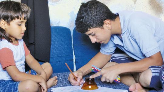 """Ahmad heeft alleen vrij op zondag. """"Tekenen was vroeger op school één van mijn lievelingsvakken."""""""