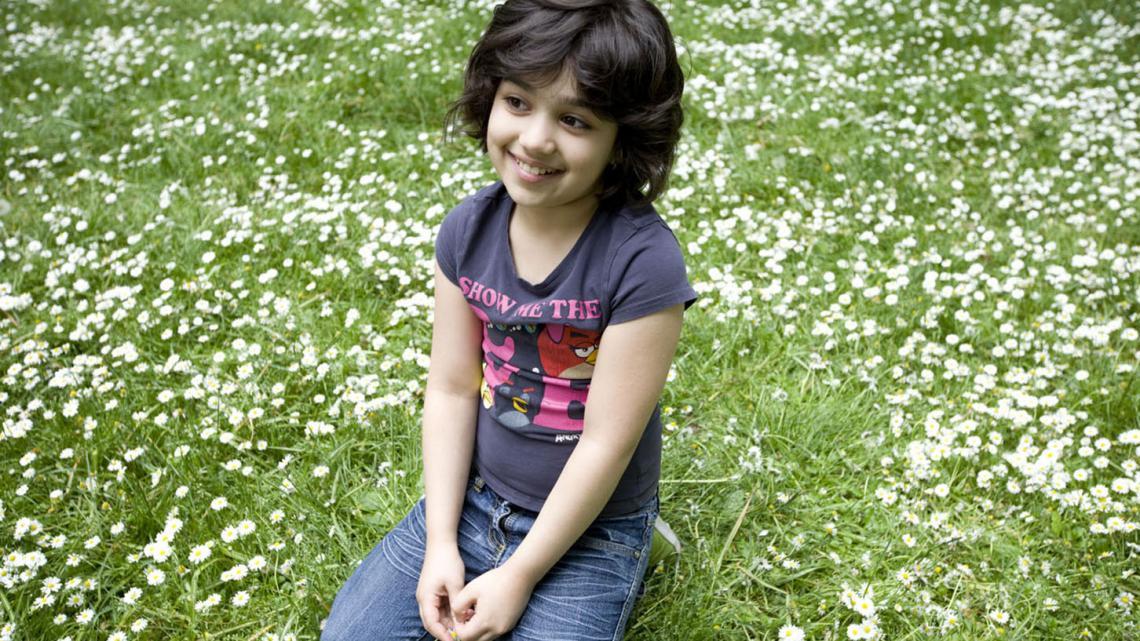 """""""Ik houd van buiten spelen op het azc"""", vertelt Huda."""